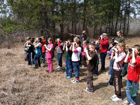 Rossman-third-grade-using-binnoculars-th